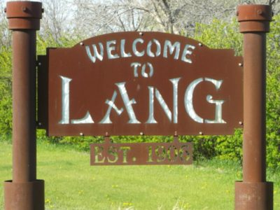 Sorry, it's not a very old Lang sign.