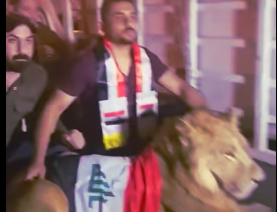 Iraqi police threatened protesters with dogs. Protesters answered by bringing a lion on the field.