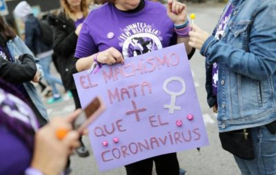 """Male pride kills more than the Coronavirus"" – a sign held by one of the thousands of closely packed together women at the women's march in Spain, one week before Spain became the epicenter of the virus."