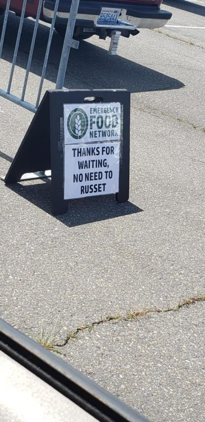 A sign at a potato giveaway.