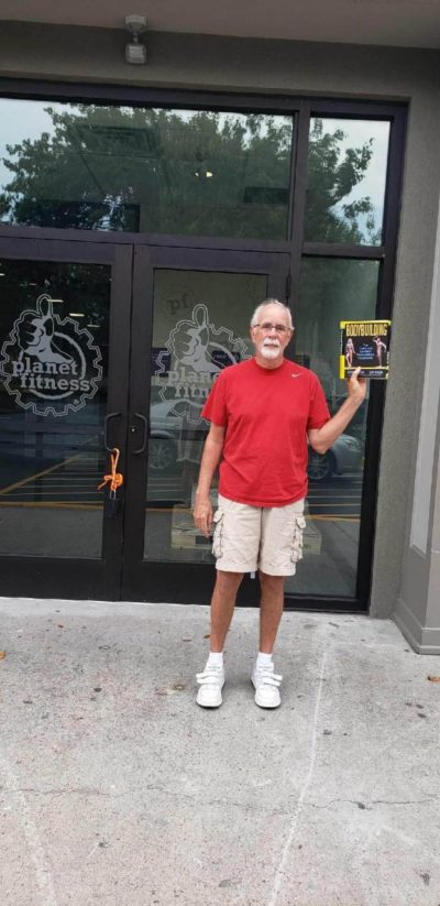 Here's my try at the POTUS Challenge, holding up a book I've never read in front of a place I never go into.
