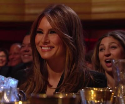 Rare photo of Melania Trump genuinely smiling. Taken at the roast of Donald Trump.